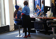 April 24, 2015 - New York, NY. A Rangers fan gets her face painted prior game 5 of the Rangers-Penguins series.  Photograph by Anthony Kane/NYCity Photo Wire