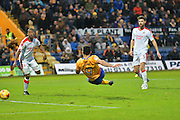 Mansfield Town forward Patrick Hoban (9) scores a goal 2-0 during the EFL Sky Bet League 2 match between Mansfield Town and Crawley Town at the One Call Stadium, Mansfield, England on 19 November 2016. Photo by Simon Trafford.