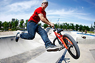 TREVOR HAGAN - Adam Baker, 20, barspins his way out of a pipe while riding his BMX at the forks. Baker has been riding for about 5 years and visits the park 3 or 4 times a week. <br /> July 7, 2009