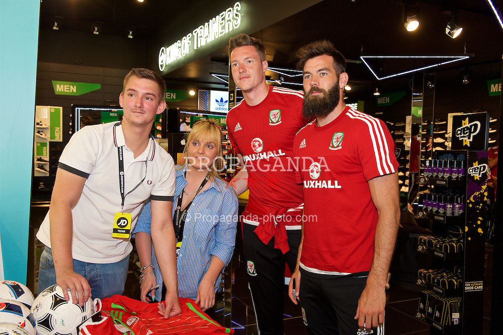 CARDIFF, WALES - Thursday, June 2, 2016: Wales' goalkeeper Wayne Hennessey and Joe Ledley during a visit to a JD Sports store in Llantrisant. (Pic by Ian Cook/Propaganda)