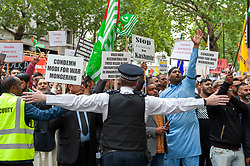 Demonstrators gathered outside India House in London to show support for Kashmiris and to protest against occupation and oppression by India in Kashmir.<br /> <br /> Police worked to keep the protesters and counter protesters apart through use of barriers, mounted police and lines of police. <br /> <br /> Richard Hancox   EEm 15082019