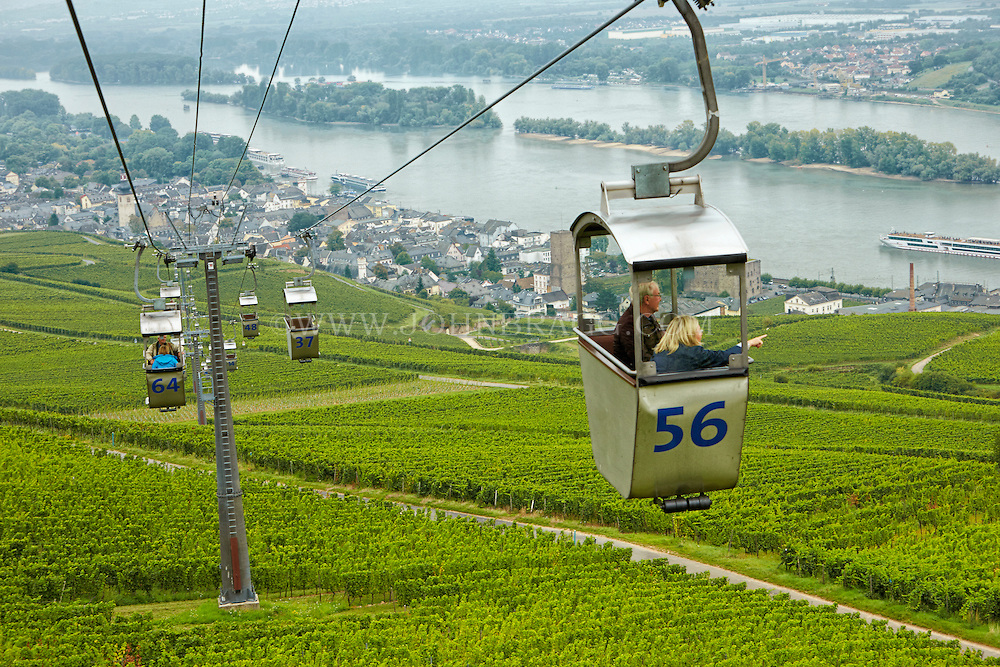 View of tourists, cable cars, vineyards, Market Square, and the Rhein, Rüdesheim, Germany.