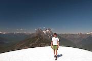 Roddy at Desolation Peak Snowfield in front of Hozomeen, North Cascades National Park, Washington, US