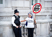 Steve Bray, Anti-Brexit activist demonstrates outside the Cabinet Office in Whitehall, London, Great Britain <br /> 21st August 2019 <br /> <br /> A SODEM activist talks to a Policeman outside the Cabinet Office whilst holding a STOP Brexit placard. <br />  <br /> Photograph by Elliott Franks