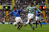 Photo: Paul Thomas.<br /> Glasgow Celtic v Glasgow Rangers. Bank of Scotland Scottish Premier League. 11/03/2007.<br /> <br /> Lee Naylor (R) of Celtic passes in-front of Nacho Novo.