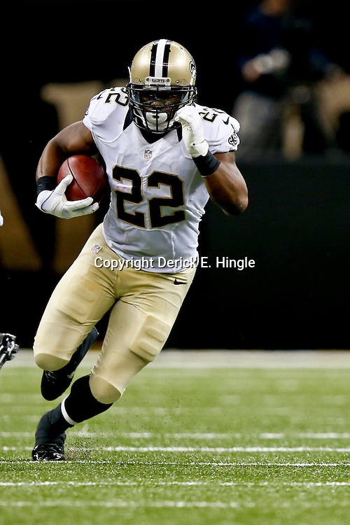 Aug 16, 2013; New Orleans, LA, USA; New Orleans Saints running back Mark Ingram (22) runs against the Oakland Raiders during the second quarter of a preseason game at the Mercedes-Benz Superdome. Mandatory Credit: Derick E. Hingle-USA TODAY Sports