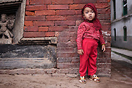 Young boy standing beside a temple, Durbar Square, Kathmandu, Nepal