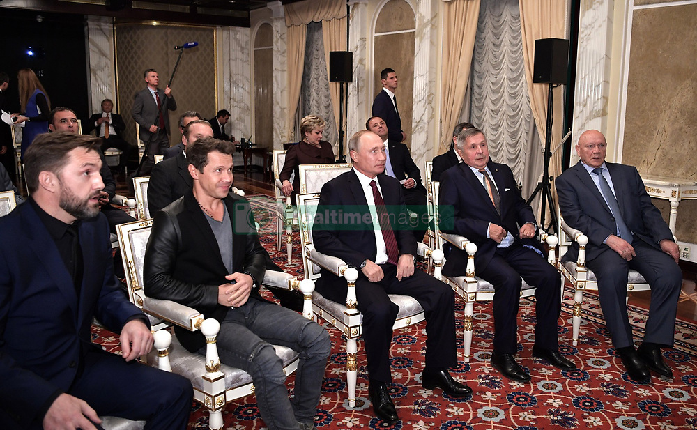 October 4, 2017 - Moscow, Russia - October 4, 2017. - Russia, Moscow. - Russian President Vladimir Putin at a meeting with the cast and crew of the film 'Salyut-7'. From left: actors Vladimir Vdovichenkov and Pavel Derevyanko. From right: cosmonauts Vladimir Dzhanibekov and Viktor Savinykh. (Credit Image: © Russian Look via ZUMA Wire)