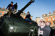 Brussels, Belgium 20160313 The Royal Belgian Military Academy had its yearly open day in Etterbeek, Brussels.The Royal Military Academy is a military institution of university education responsible for the basic academic, military and physical training of future officers.young girl in pink taken by father after having a look at a real tank