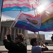 Shannon Glatz, left, with her partner, Liberty Manos, center, and Alex Rangel, of Get Equal, demonstrated near the steps of the Supreme Court during the hearings about the constitutionality of the Defense of Marriage Act (DOMA) on Wednesday, March 27, 2013.  Glatz and Manos were married in a mass ceremony near the steps of the Supreme Court with 24 other LGBT couples on June 21, 2013. John Boal Photography