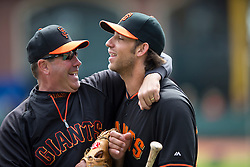 SAN FRANCISCO, CA - APRIL 26:  Former player Will Clark of the San Francisco Giants jokes with Madison Bumgarner #40 before the game against the Cleveland Indians at AT&T Park on April 26, 2014 in San Francisco, California. The San Francisco Giants defeated the Cleveland Indians 5-3.  (Photo by Jason O. Watson/Getty Images) *** Local Caption *** Will Clark; Madison Bumgarner