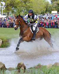 Sam Griffiths and PAULANK BROCKAGH - Cross Country phase, Mitsubishi Motors Badminton Horse Trials, Badminton House, Gloucestershire, United Kingdom, Saturday, 10th May 2014. Picture by Nico Morgan / i-Images