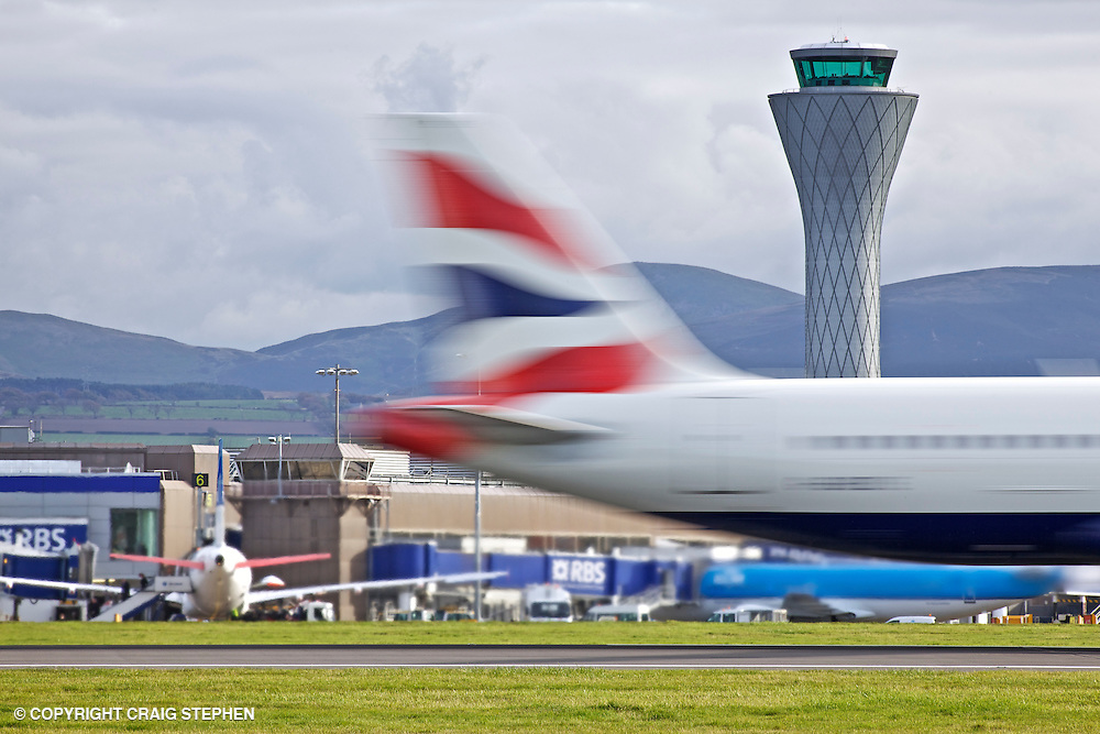 A British Airways (BA) plane blurred on the runway at Edinburgh aiport, Scotland, UK