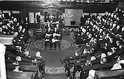 President John F. Kennedy makes history in Ireland when for the first time a visitor addressed both houses of the Oireachtas (Parliament) in Dublin.  It was also the first time that news photographs were allowed to be taken during a sitting of the houses.  Members of the Goverenment led by Taoiseach Seán Lemass are seated on the left hand side of the house. The oppsition benches are on the right.