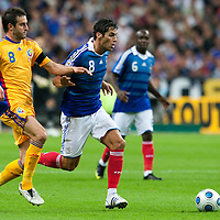 05 September 2009: French forward Yoann Gourcuff  vies with Romanian player Maximilian Nicu during the World Cup 2010 qualifying football match France vs. Romania (1-1), on September 5, 2009 at the Stade de France stadium in Saint-Denis, near Paris, France.