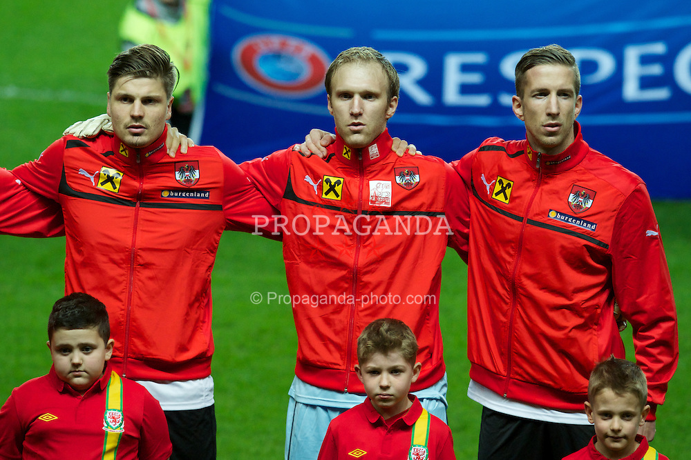 SWANSEA, WALES - Wednesday, February 6, 2013: Austria's Sebastian Prodl, goalkeeper Robert Almer and captain Marc Janko line-up before the International Friendly against Wales at the Liberty Stadium. (Pic by Tom Hevezi/Propaganda)