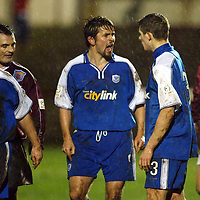 Arbroath v St Johnstone..  01.01.03<br />Paul Hartley gives Ross Forsyth and ear bashing after the youngster starting pushing and shoving risking getting booked<br /><br />Pic by Graeme Hart<br />Copyright Perthshire Picture Agency<br />Tel: 01738 623350 / 07990 594431