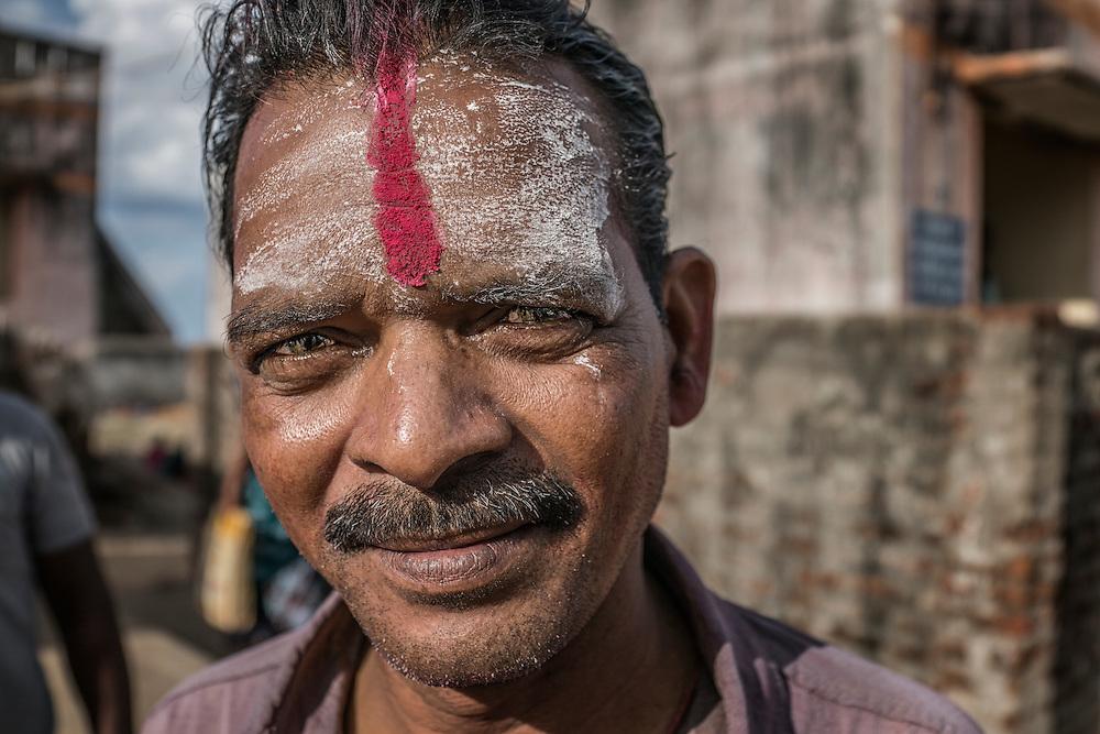 Villager at a Ganesh Chaturthi Festival.  Tiruchchepuram, Tamil Nadu, India.