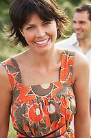 Smiling Woman walking on beach trail portrait