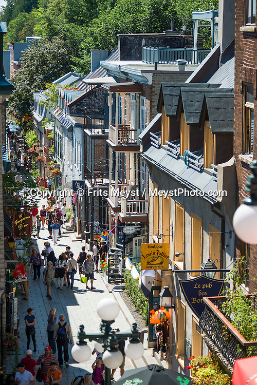 Quebec, Canada, August 2014. Old Québec is famous for its European charm and well-preserved architectural treasures. The entire district, which is best explored on foot, is a living history book, and every garden, building and street corner is its own chapter. Quebec province is unique among North American tourist destinations. Its French heritage does not only set the province apart from most of its English speaking neighbors, it is also one of the few historical areas in North America to have fully preserved its Francophone culture. Its European feel and its history, culture and warmth have made Quebec a favourite tourist destination both nationally and internationally. Photo by Frits Meyst / MeystPhoto.com