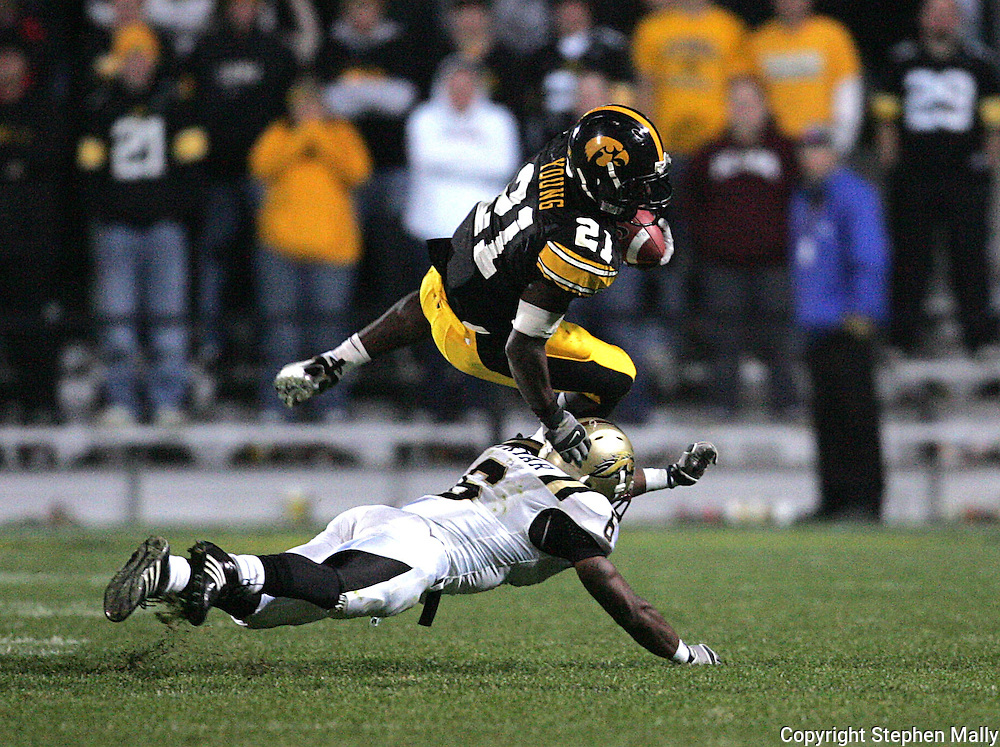 17 NOVEMBER 2007: Iowa running back Albert Young (21) tries to jump over Western Michigan cornerback Londen Fryar (6) in Western Michigan's 28-19 win over Iowa at Kinnick Stadium in Iowa City, Iowa on November 17, 2007.