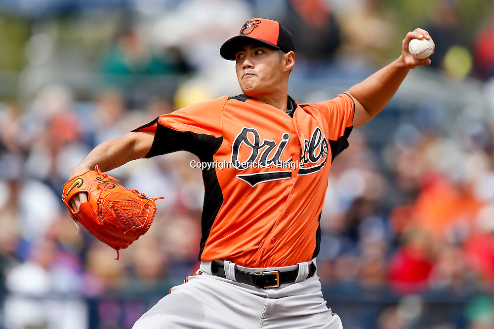 Mar 2, 2013; Port Charlotte, FL, USA; Baltimore Orioles starting pitcher Wei-Yin Chen (16) throws against the Tampa Bay Rays during the bottom of the first inning inning of a spring training game at Charlotte Sports Park. Mandatory Credit: Derick E. Hingle-USA TODAY Sports
