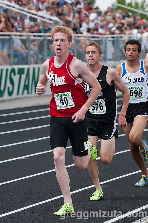 Boise senior Thomas Rigby, Rocky Mountain senior Justin Ross, and Timberline sophomore Andrew Rafla lead the pack during the third lap of the Idaho High School State Track and Field Championships 5A 1600 meter run on May 18, 2013 at Eagle High School, Eagle, Idaho.<br />