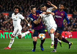 BARCELONA, Feb. 7, 2019  Real Madrid's Karim Benzema (2nd R) competes with FC Barcelona's Nelson Semedo (1st R) and Clement Lenglet (2nd L) during the Spanish King's Cup semifinal first leg match between FC Barcelona and Real Madrid in Barcelona, Spain, on Feb. 6, 2019. The match ended with a 1-1 draw. (Credit Image: © Joan Gosa/Xinhua via ZUMA Wire)