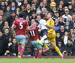 West Ham's James Tomkins, West Ham's Stewart Downing, Tottenham Hotspur's Danny Rose and West Ham's Adrian in action - Photo mandatory by-line: Mitchell Gunn/JMP - Mobile: 07966 386802 - 22/02/2015 - SPORT - football - London - White Hart Lane - Tottenham Hotspur v West Ham United - Barclays Premier League