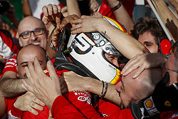 March 25, 2018 - Melbourne, Victoria, Australia - Race winner SEBASTIAN VETTEL celebrates with Scuderia Ferrari teammates after the 2018 Formula One Australian Grand Prix, at Albert Park. (Credit Image: © Hoch Zwei via ZUMA Wire)
