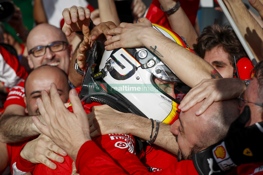 March 25, 2018 - Melbourne, Victoria, Australia - Race winner SEBASTIAN VETTEL celebrates with Scuderia Ferrari teammates after the 2018 Formula One Australian Grand Prix, at Albert Park. (Credit Image: © Hoch Zwei via ZUMA Wire)