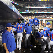 NEW YORK, NEW YORK - July 01: Kris Bryant #17 of the Chicago Cubs is congratulated by teammates as he returns to the dugout during the Chicago Cubs Vs New York Mets regular season MLB game at Citi Field on July 01, 2016 in New York City. (Photo by Tim Clayton/Corbis via Getty Images)