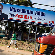A man walks by a billboard promoting New Patriotic Party (NPP) candidate Nana Akufo-Addo ahead of the upcoming presidential elections in Accra, Ghana on Monday September 8, 2008.