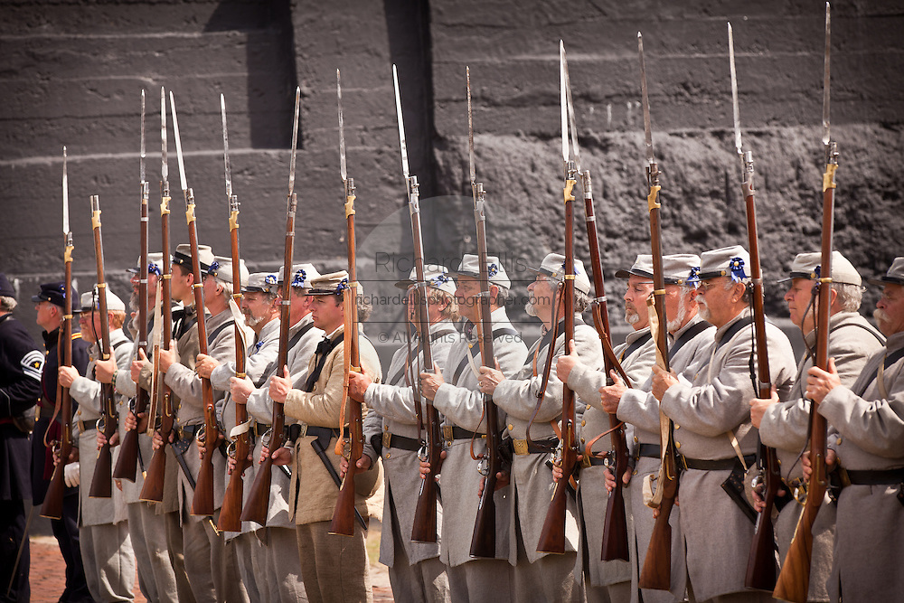 Confederate troops stand at attention at Fort Sumter on the 150th anniversary of the surrender of the fort in the US Civil War on April 14, 2011 in Charleston, South Carolina.  The surrender of the fort marks the end of a week long commemoration of the start of the Civil War.