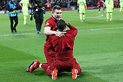 Liverpool midfielder James Milner (7) and Liverpool midfielder Georginio Wijnaldum (5) celebrate the historic win 4-0 during the Champions League semi-final, leg 2 of 2 match between Liverpool and Barcelona at Anfield, Liverpool, England on 7 May 2019.