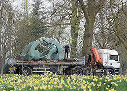 ©London News pictures. 28/03/2011. The lorry arrives with the sculpture. Workers install Henry Moore's 'Hill Arches (lH636)' at the historic Hatfield House, Hertfordshire today (Mon). The iconic bronze sculpture weighs in at 5400Kilos (5.4 Ton) and needed a special trackway to be built ahead of it's arrival on a truck. The scultpure forms part of an exhibition which is open to the public 23rd April to 30th September 2011. Hatfield House was the former home of Elizabeth 1st. Picture credit should read Stephen Simpson/LNP