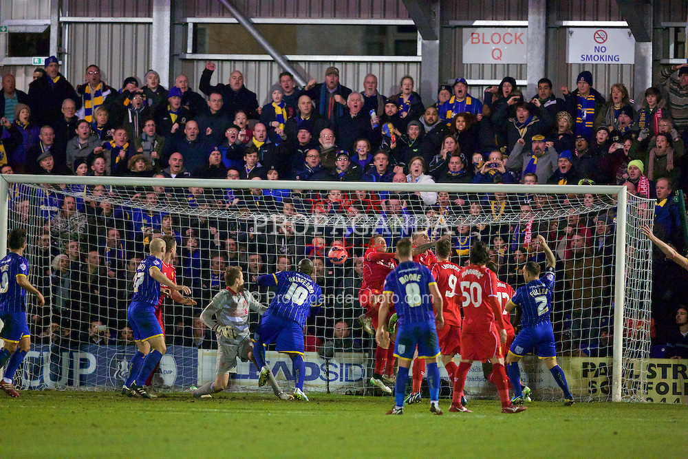KINGSTON-UPON-THAMES, ENGLAND - Monday, January 5, 2015: AFC Wimbledon's Adebayo Akinfenwa scores the first goal against Liverpool during the FA Cup 3rd Round match at the Kingsmeadow Stadium. (Pic by David Rawcliffe/Propaganda)