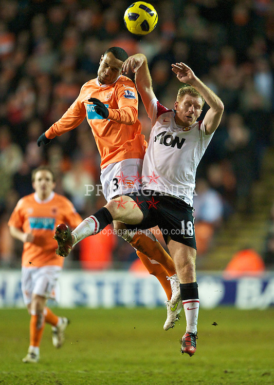 BLACKPOOL, ENGLAND - Tuesday, January 25, 2011: Manchester United's Paul Scholes and Blackpool's Matt Phillips during the Premiership match at Bloomfield Road. (Photo by David Rawcliffe/Propaganda)