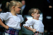 Highland Dancing - A young girl poses for the judges at the end of her highland dance competition during the Highland Games in St. Andrews, Scotland.