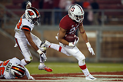 PALO ALTO, CA - NOVEMBER 10: Running back Cameron Scarlett #22 of the Stanford Cardinal scores a touchdown past cornerback Isaiah Dunn #23 of the Oregon State Beavers and cornerback Jaydon Grant #26 during the third quarter at Stanford Stadium on November 10, 2018 in Palo Alto, California. The Stanford Cardinal defeated the Oregon State Beavers 48-17. (Photo by Jason O. Watson/Getty Images) *** Local Caption *** Cameron Scarlett; Isaiah Dunn; Jaydon Grant