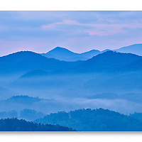 Contrasting warm and cool tones at sunrise with fog in the valley below along the Foothills Parkway Tennessee