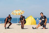 BERGEN - 03-08-2015, strandtraining AZ, strand, AZ speler Ridgeciano Haps (l), AZ speler Derrick Luckassen (m), AZ speler Joris van Overeem (r).