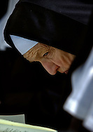 BETHLEHEM, CT- 11 OCTOBER 2005- A sister of the Abbey of Regina Laudis bows in prayer at the burial for Mother Benedict Duss, founder and first Abbess of the Benedictine order abbey. The abbey founded by Mother Bendict was the first female Bendictine abbey in the United States. (Photo by Robert Falcetti)