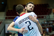 Julien Lyneel and Jenia Grebennikov both from France celerate victory after the 2013 CEV VELUX Volleyball European Championship match between France and Slovakia at Ergo Arena in Gdansk on September 20, 2013.<br /> <br /> Poland, Gdansk, September 20, 2013<br /> <br /> Picture also available in RAW (NEF) or TIFF format on special request.<br /> <br /> For editorial use only. Any commercial or promotional use requires permission.<br /> <br /> Mandatory credit:<br /> Photo by &copy; Adam Nurkiewicz / Mediasport