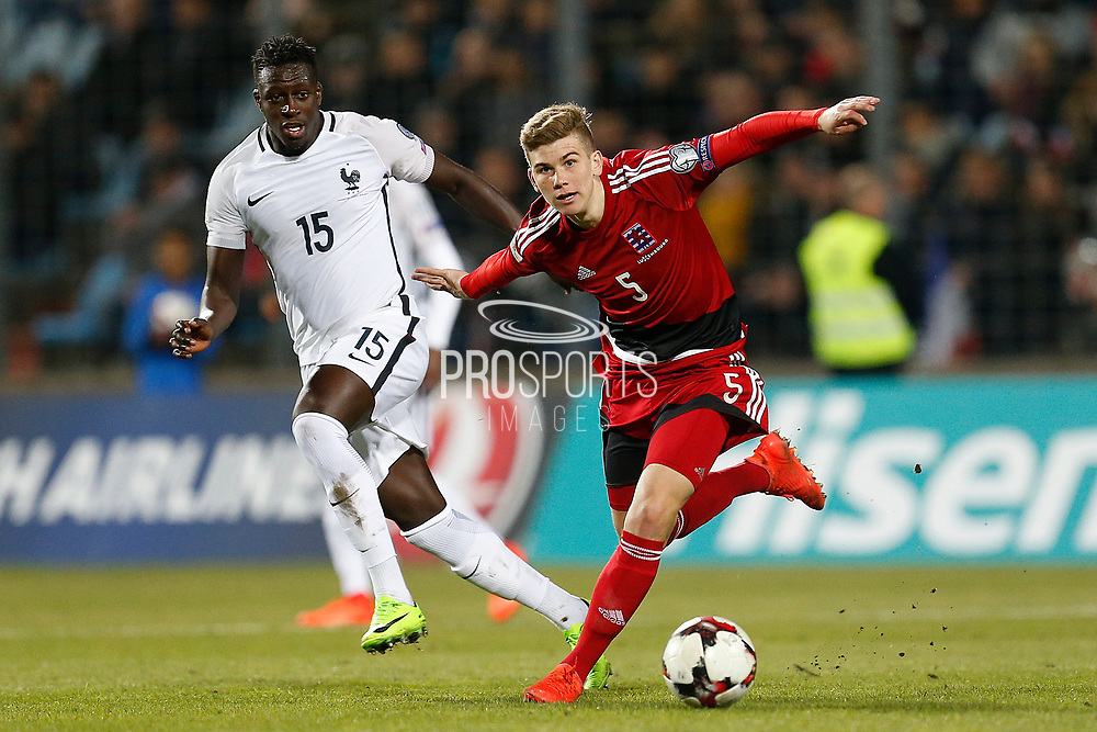 Luxembourg's Florian Bohnert vies with France's defender Benjamin Mendy during the FIFA World Cup 2018 qualifying football match, Group A, between Luxembourg and France on March 25, 2017 at Josy Barthel stadium in Luxembourg - Photo Benjamin Cremel / ProSportsImages / DPPI