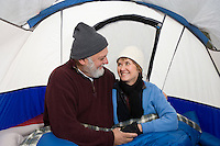 Senior couple embracing in a tent