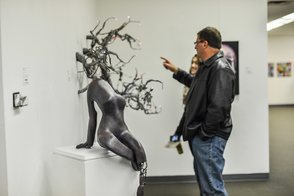 Residents viewing the art displayed at Summit Artspace during Akron Art Prize 2014.