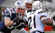 Tedy Bruschi goes after Ladanian Tomlinson during on of his two carries, before sitting out the rest of the game.