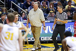 Jan 2, 2019; Morgantown, WV, USA; West Virginia Mountaineers head coach Bob Huggins talks to an official during the first half against the Texas Tech Red Raiders at WVU Coliseum. Mandatory Credit: Ben Queen-USA TODAY Sports