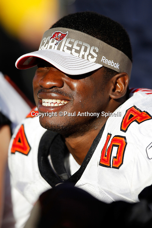 Tampa Bay Buccaneers linebacker Geno Hayes (54) wears a sun visor while taking a bench break during the NFL week 11 football game against the San Francisco 49ers on Sunday, November 21, 2010 in San Francisco, California. The Bucs won the game 21-0. (©Paul Anthony Spinelli)